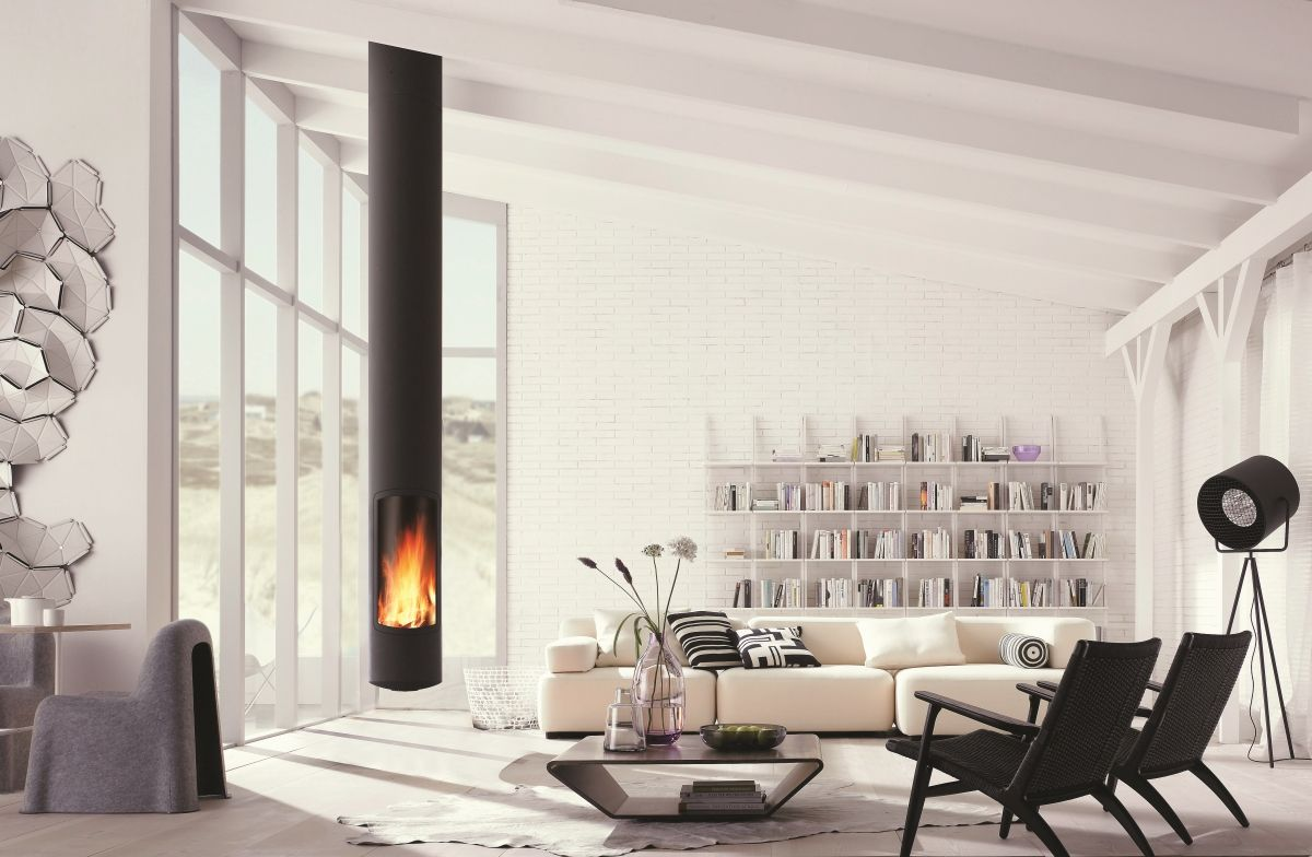 """Schoener Wohnen, 2009, 7, 24. Exclusive worldwide through Picture Press or partners.  living, habitation, """"home decor"""", """"interior design"""", interior, """"interior decoration"""", ambiente, architecture, """"living room"""", fireside, fireplace, functional, timber, wood, """"wooden beams"""", open, flame, fire, window, sofa, """"Alphabet"""", """"libri"""", spotlight, white, bright, armchair, wooden chair, chairs, """"coffee table"""", shelf, bookshelf, bookcase, """"set of book shelves"""", Spartan, """"solid wood"""", douglasie"""